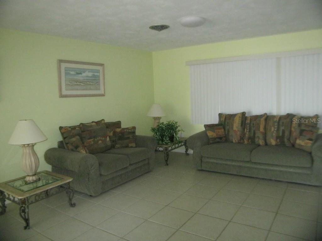 This is the living room area. - Single Family Home for sale at 450 Coral Creek Dr, Placida, FL 33946 - MLS Number is D5901346