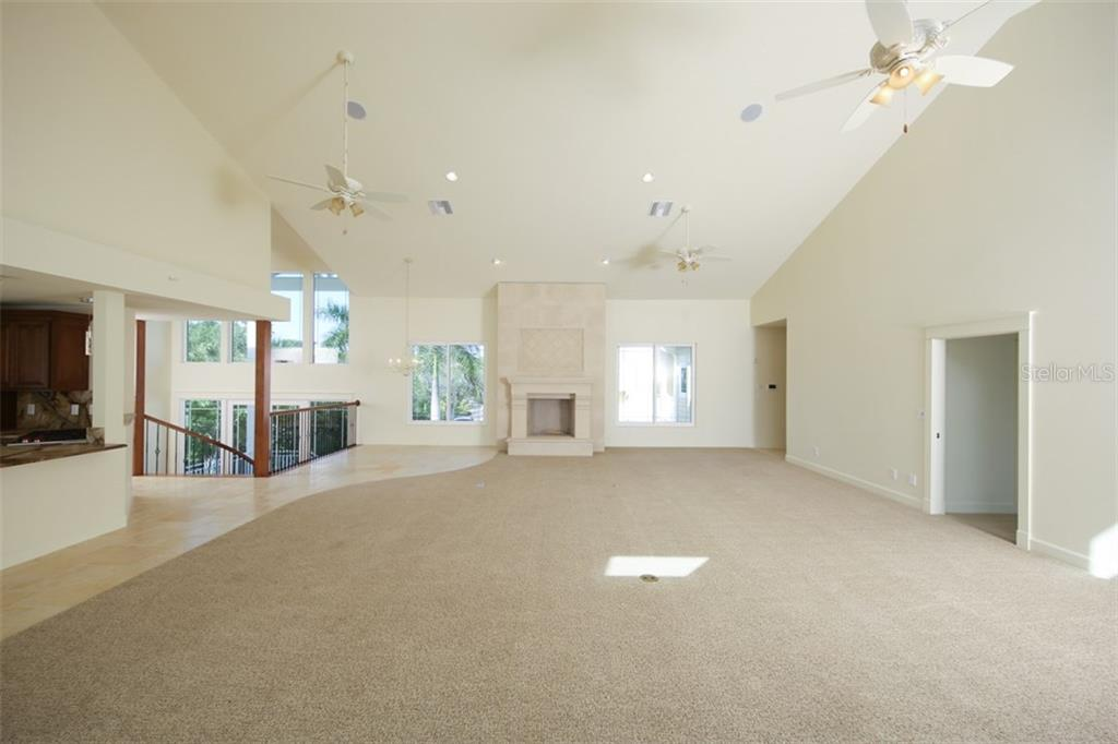 Great Room with Stone Fireplace - Single Family Home for sale at 7295 Manasota Key Rd, Englewood, FL 34223 - MLS Number is D5911936