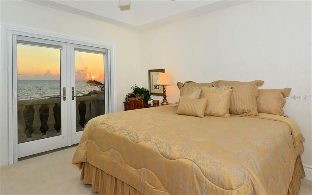 Guest Bedroom 1 overlooking the sunset - Single Family Home for sale at 730 N Manasota Key Rd, Englewood, FL 34223 - MLS Number is D5912725
