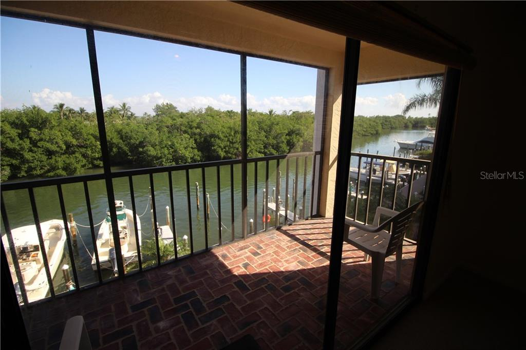 Sliders from Masterbedroom to Lanai - Condo for sale at 970 Palm Ave #225, Boca Grande, FL 33921 - MLS Number is D5915744