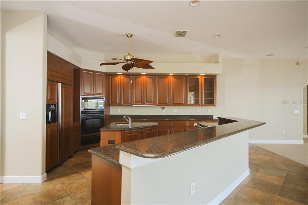 Kitchen with large breakfast bar, Granite, many cabinets and prep island - Single Family Home for sale at 550 Coral Creek Dr, Placida, FL 33946 - MLS Number is D5917129