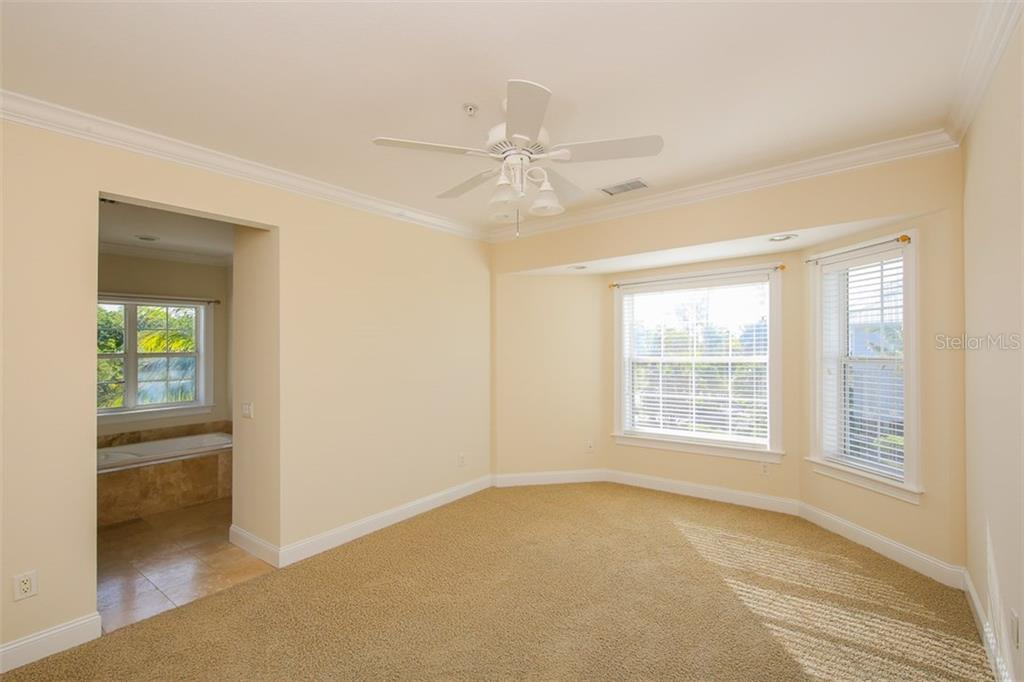 Downstairs Second Master Bedroom - Single Family Home for sale at 7020 Palm Island Dr, Placida, FL 33946 - MLS Number is D5917629