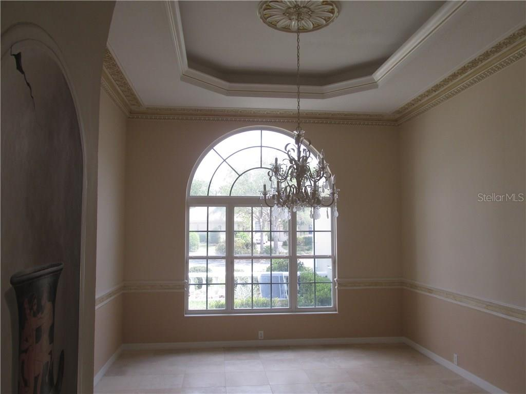 The home features a large formal dining room with extensive trim and tray ceiling.  Marble floors cover most of the first floor and will be polished back to perfection shortly - Single Family Home for sale at 3001 Rivershore Ln, Port Charlotte, FL 33953 - MLS Number is D5917929