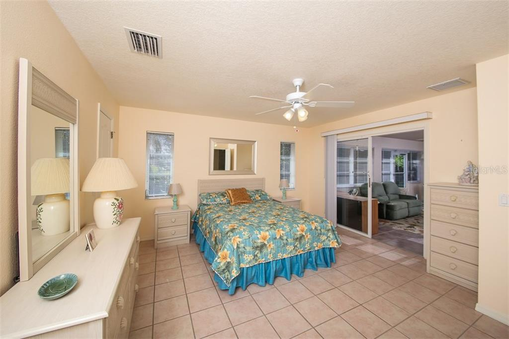 Master Bedroom - Single Family Home for sale at 7044 Quigley St, Englewood, FL 34224 - MLS Number is D5918526