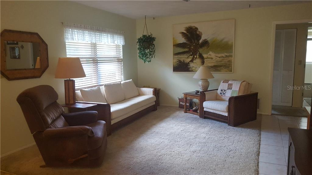 This is one view of the living room while furnished. - Single Family Home for sale at 21068 Halden Ave, Port Charlotte, FL 33952 - MLS Number is D5918749