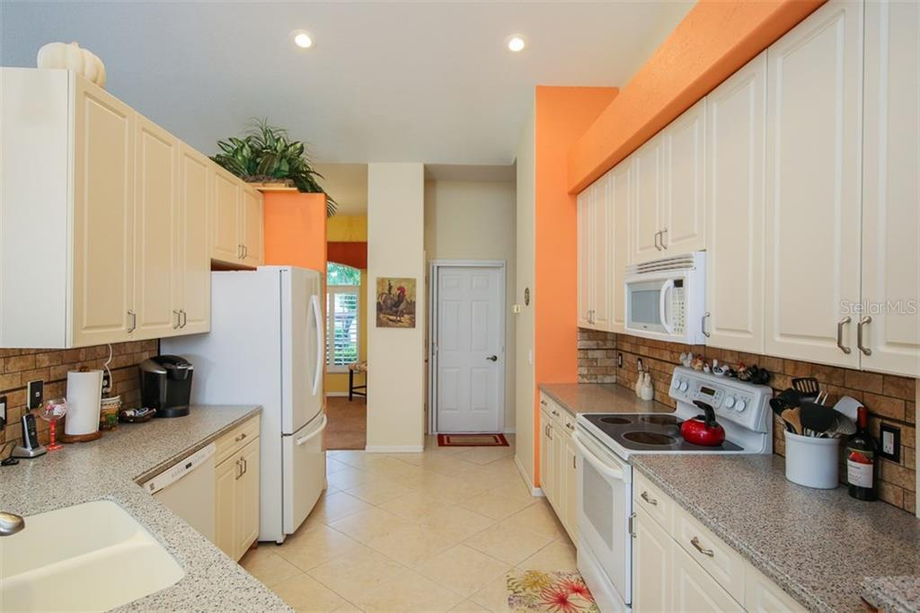 Kitchen - Single Family Home for sale at 5660 Riviera Ct, North Port, FL 34287 - MLS Number is D5919107