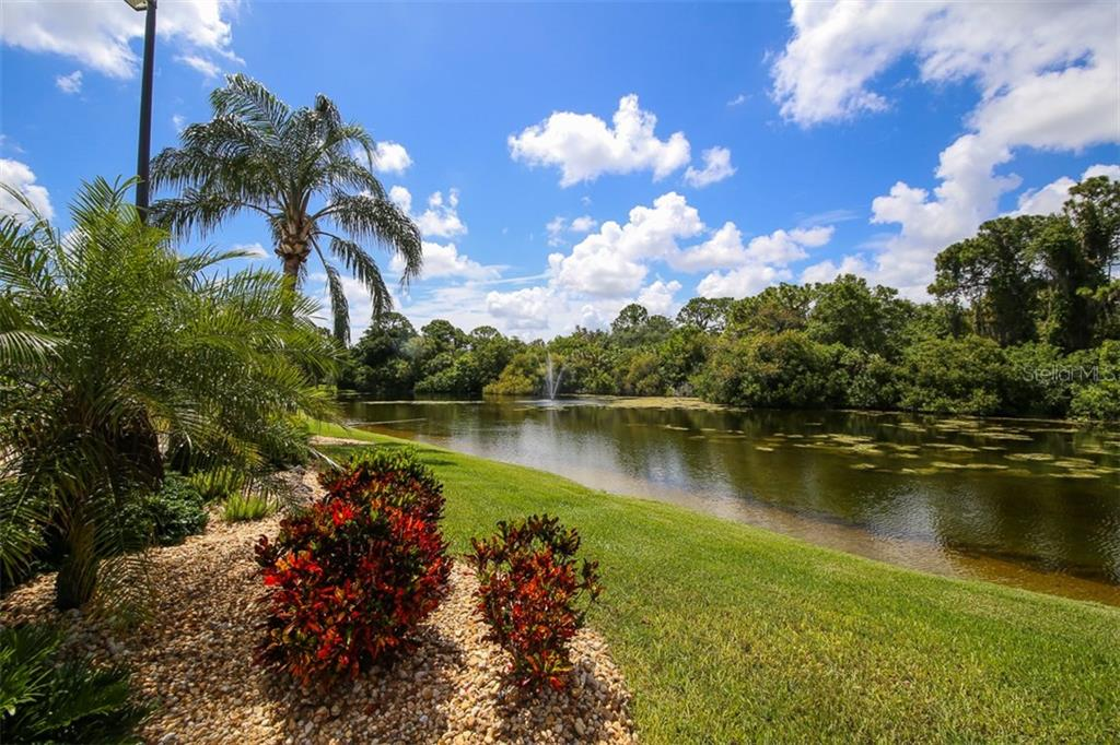 Lake view to left - Single Family Home for sale at 317 Indian River Ln, Englewood, FL 34223 - MLS Number is D5919375
