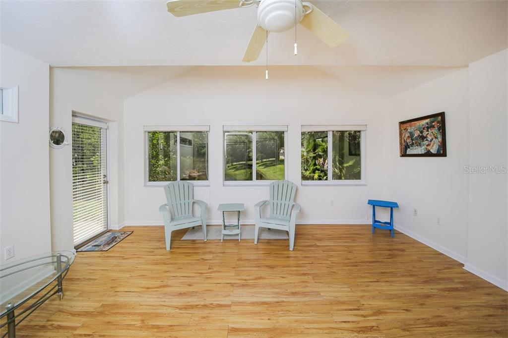 Air conditioned Florida Room - Single Family Home for sale at 317 Indian River Ln, Englewood, FL 34223 - MLS Number is D5919375