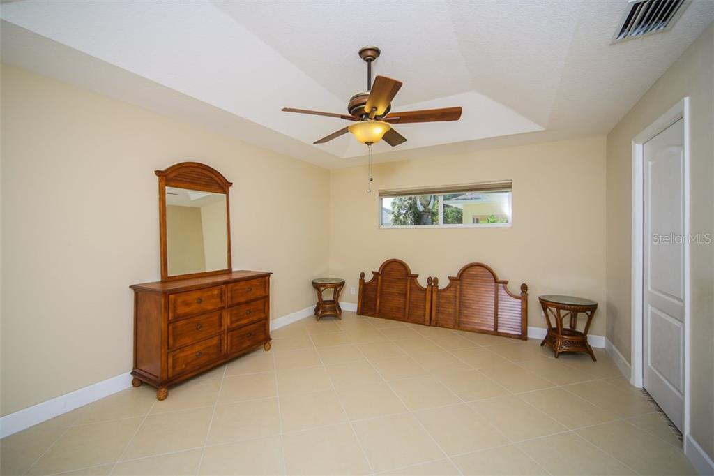 Master bedroom - room for a king sized bed - Single Family Home for sale at 414 Tomoka Dr, Englewood, FL 34223 - MLS Number is D5919831