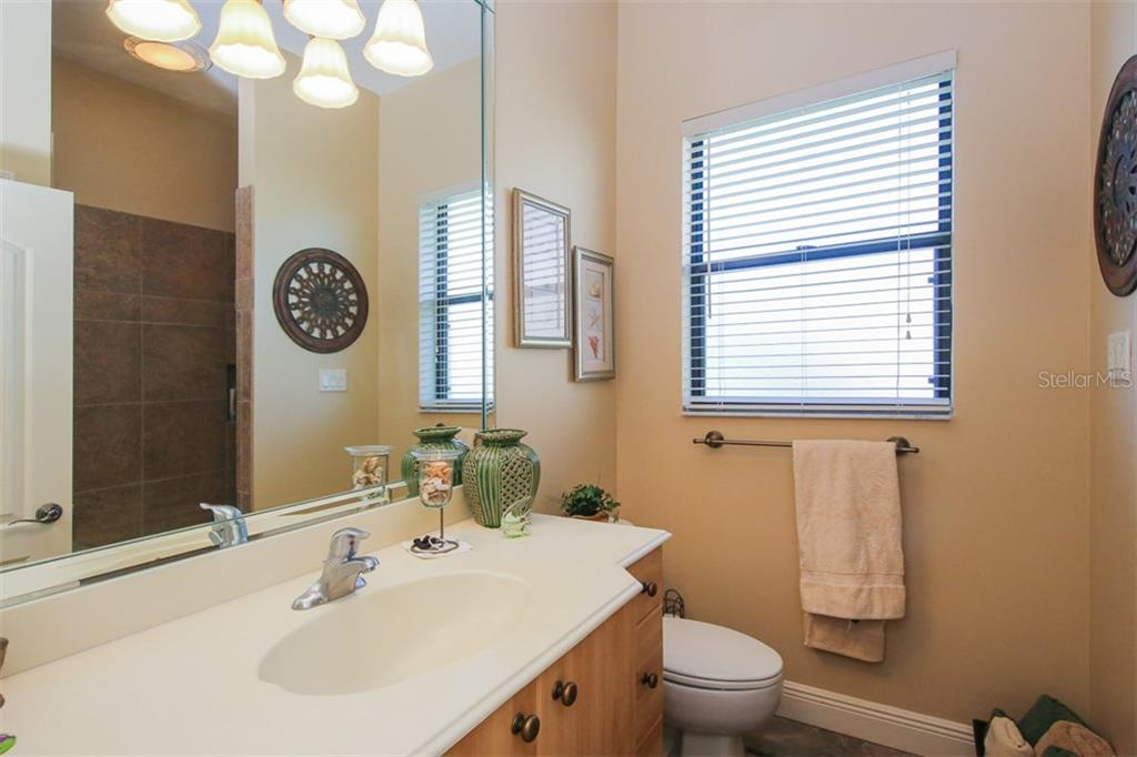 GUEST BATH - Single Family Home for sale at 2634 Royal Palm Dr, North Port, FL 34288 - MLS Number is D5920557