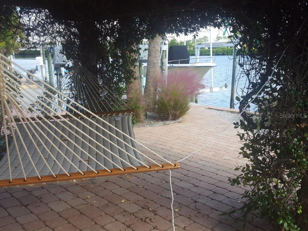 What would a luxury retreat be without the hammock under the jasmine-covered trellis overlooking the water! - Single Family Home for sale at 1439 Deer Creek Dr, Englewood, FL 34223 - MLS Number is D5921060