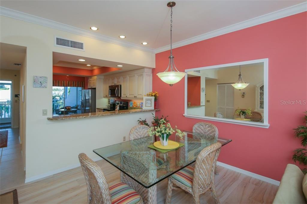 Dining Room-Kitchen - Condo for sale at 11000 Placida Rd #309, Placida, FL 33946 - MLS Number is D5921681