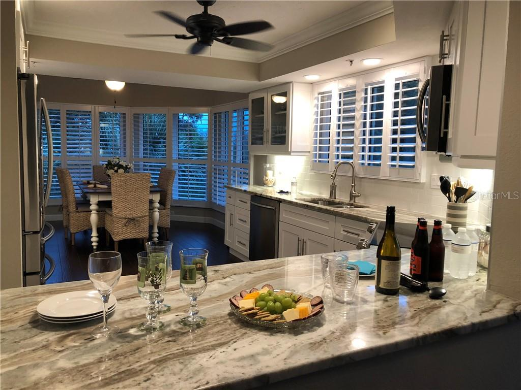 Breakfast Nook has been opened to the kitchen making large family gatherings possible. - Condo for sale at 11000 Placida Rd #1303, Placida, FL 33946 - MLS Number is D5921767