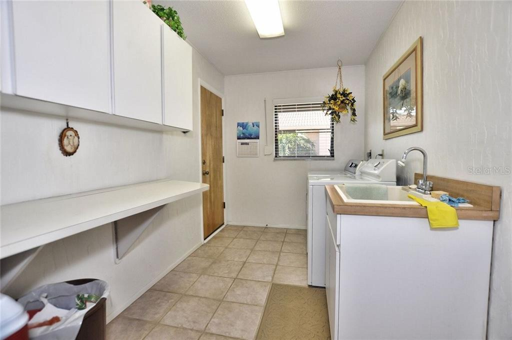 Spacious Laundry room - Single Family Home for sale at 9 Pine Ridge Way, Englewood, FL 34223 - MLS Number is D5921839