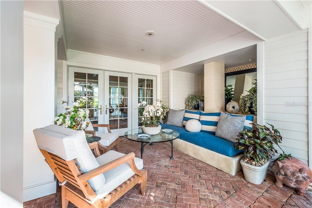 Breakfast area with corner banquette - Single Family Home for sale at 16160 Sunset Pines Cir, Boca Grande, FL 33921 - MLS Number is D5922901