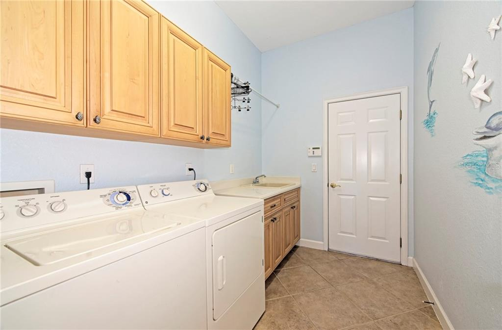 Laundry room - Single Family Home for sale at 409 Montelluna Drive, North Venice, FL 34275 - MLS Number is D5923522