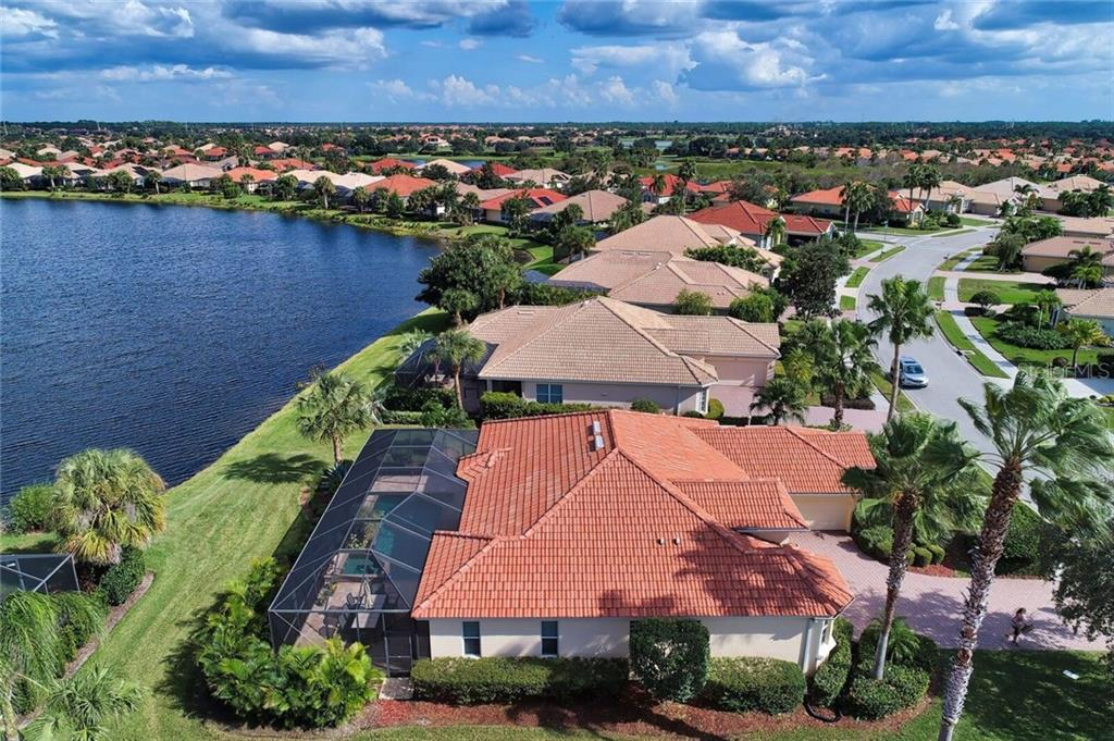 Side aerial view of 409 Montelluna Drive - Single Family Home for sale at 409 Montelluna Drive, North Venice, FL 34275 - MLS Number is D5923522