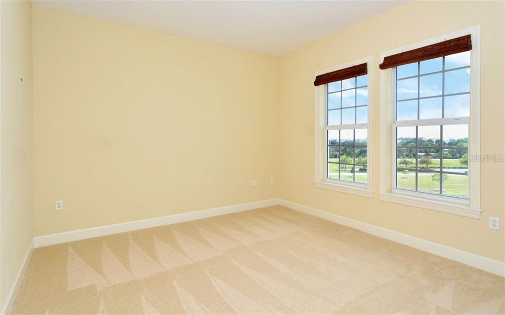 2nd Spacious bedroom - Condo for sale at 8561 Amberjack Cir #402, Englewood, FL 34224 - MLS Number is D5923600