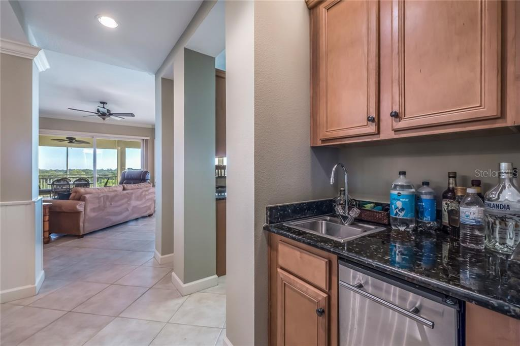 Wet bar and wine refrigerator - Condo for sale at 8541 Amberjack Cir #402, Englewood, FL 34224 - MLS Number is D5923680