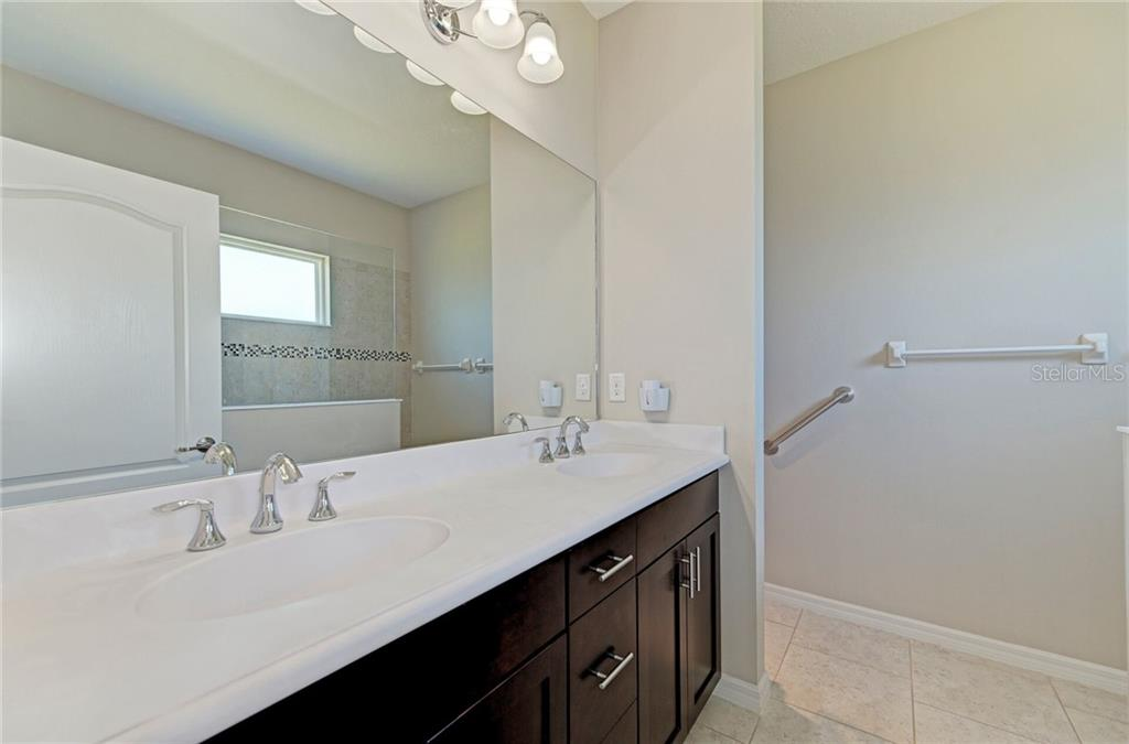 Dual sinks, ceramic tile, and cabinet space galore. - Single Family Home for sale at 141 Avens Dr, Nokomis, FL 34275 - MLS Number is D6100104
