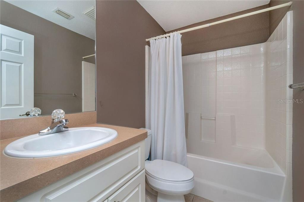 Guest Bathroom - Single Family Home for sale at 11205 Gulfstream Blvd, Port Charlotte, FL 33981 - MLS Number is D6100390