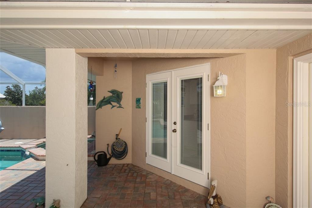Courtyard Bedroom Entrance - Single Family Home for sale at 222 Westwind Dr, Placida, FL 33946 - MLS Number is D6100545