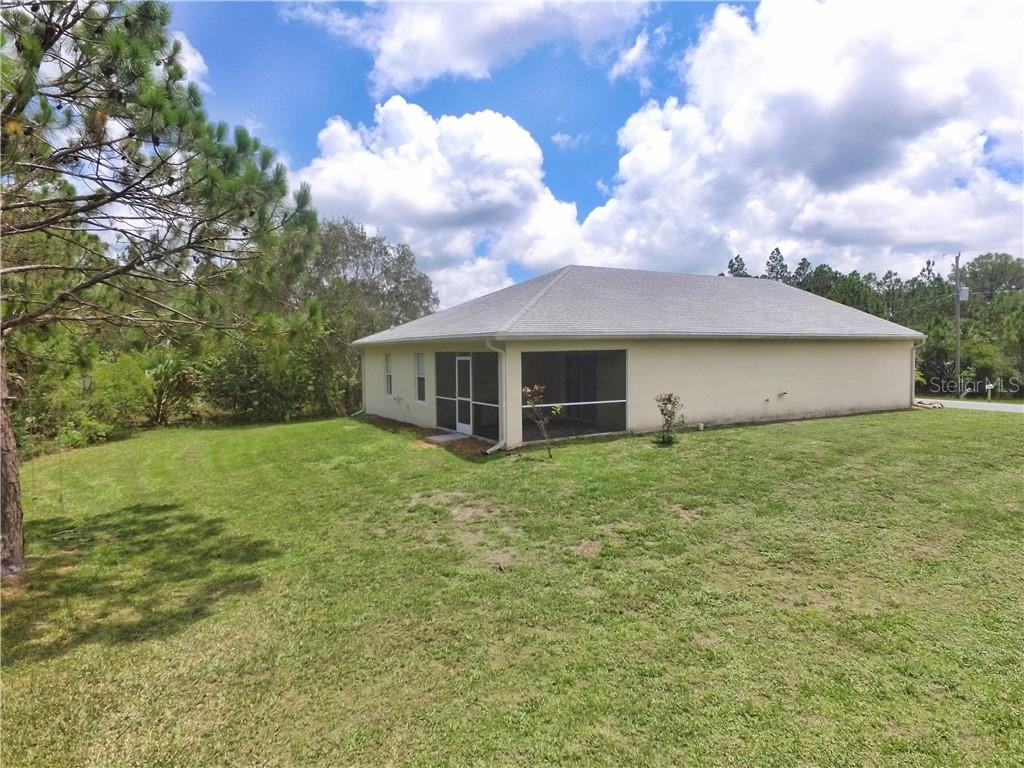 Side and back yard.  Septic tank and field are on the side of the home.  Giving you plenty of room for a pool in the back yard. - Single Family Home for sale at 4414 Callaway St, Port Charlotte, FL 33981 - MLS Number is D6100799