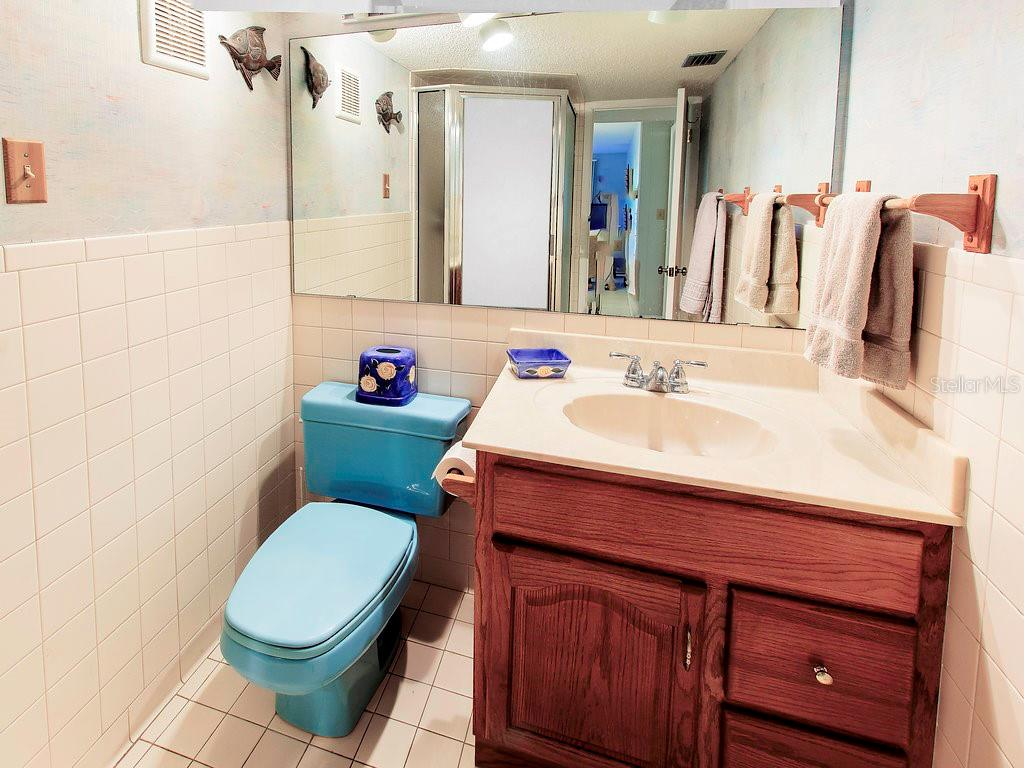 Bathroom with shower off of the large bedroom and living/dining space. - Condo for sale at 2980 N Beach Rd #c2-4, Englewood, FL 34223 - MLS Number is D6101944