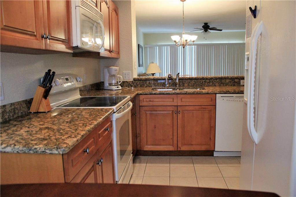 Fully equiped kitchen with granite countertops. - Condo for sale at 8409 Placida Rd #403, Placida, FL 33946 - MLS Number is D6102047