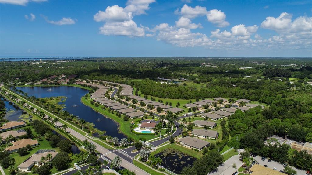 Stillwater Villas has two convenient entrances, one on the west end and this one located near the clubhouse on the east end. - Villa for sale at 29704 Niagara Ct, Englewood, FL 34223 - MLS Number is D6102386