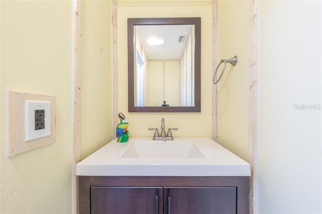Laundry area half bath - Single Family Home for sale at 7339 Hawkins Rd, Sarasota, FL 34241 - MLS Number is D6102762