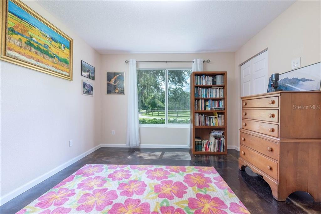 The second bedroom faces the front and has an extra large closet and is wired for a wall mount tv as most rooms are in both houses. - Single Family Home for sale at 7339 Hawkins Rd, Sarasota, FL 34241 - MLS Number is D6102762