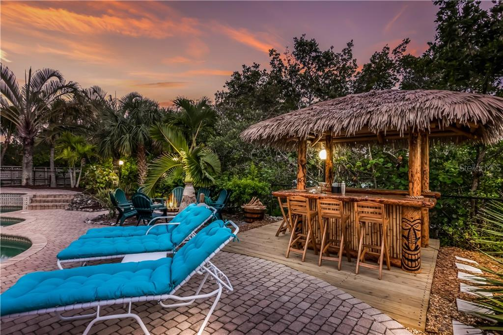 Resort style pool, pergola, bonfire, dock, tiki bar! - Single Family Home for sale at 101 N Gulf Blvd, Placida, FL 33946 - MLS Number is D6103476