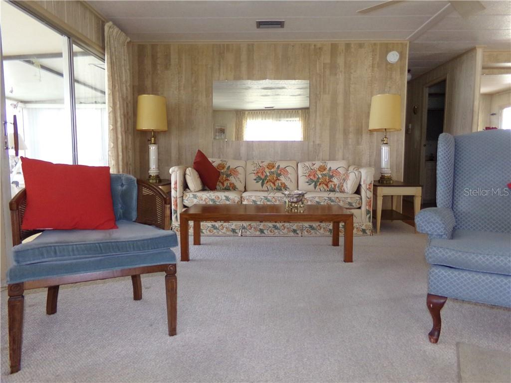 Another view of charming Living Room - Manufactured Home for sale at 6294 Bunting Ln, Englewood, FL 34224 - MLS Number is D6103685