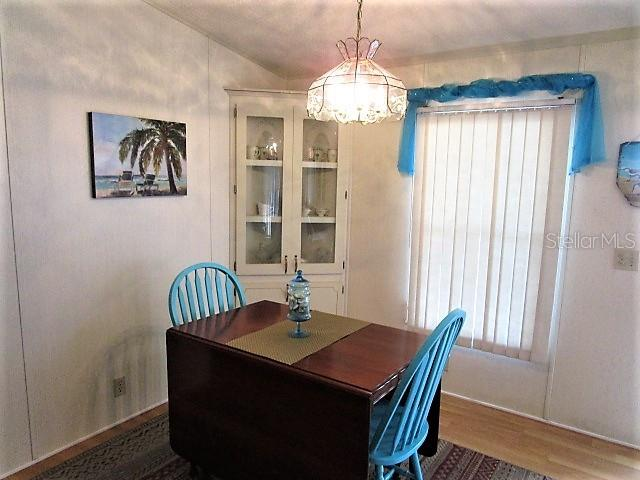 Dining area has cathedral ceiling. - Manufactured Home for sale at 1800 Englewood Rd #95, Englewood, FL 34223 - MLS Number is D6103776