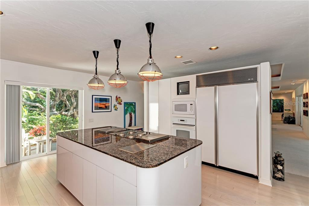 The cook will be the center of attention in this well designed kitchen! - Single Family Home for sale at 7400 Manasota Key Rd, Englewood, FL 34223 - MLS Number is D6104362