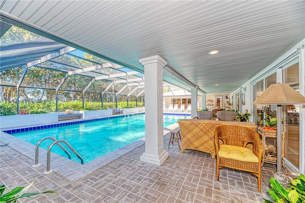 Plenty of room for entertaining on the wrap around deck. - Single Family Home for sale at 7400 Manasota Key Rd, Englewood, FL 34223 - MLS Number is D6104362