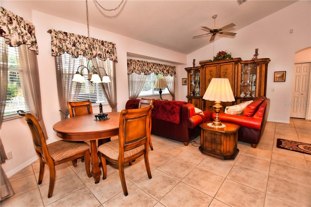 Dinette opens to the Family room and Kitchen, with sliding doors to the Lanai and pool area. - Single Family Home for sale at 8 Medalist Cir, Rotonda West, FL 33947 - MLS Number is D6104474
