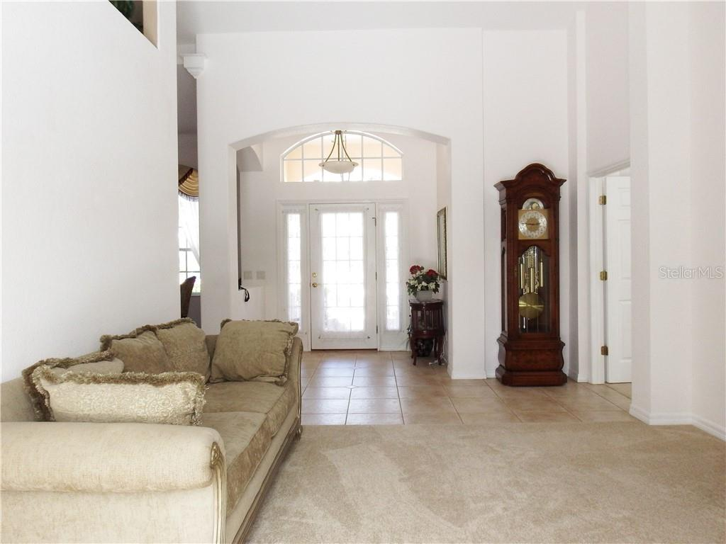 1st Living area, sliding doors to the Screened in Lanai and pool area. - Single Family Home for sale at 8 Medalist Cir, Rotonda West, FL 33947 - MLS Number is D6104474