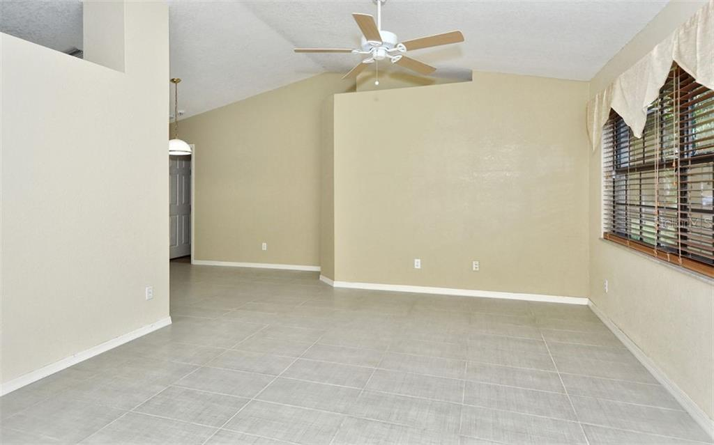Living Room with new Tile Flooring - Single Family Home for sale at 5376 Ashwood Rd, Port Charlotte, FL 33981 - MLS Number is D6105888