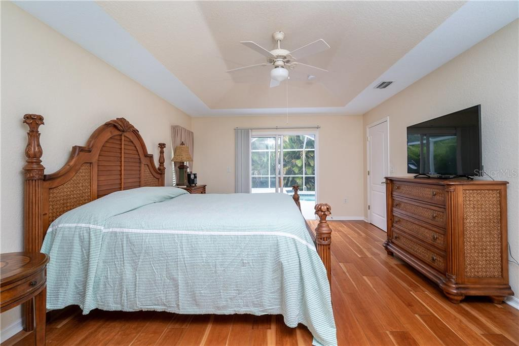 Master bedroom has sliding glass doors to Lanai and pool area. - Single Family Home for sale at 30 Medalist Way, Rotonda West, FL 33947 - MLS Number is D6106239