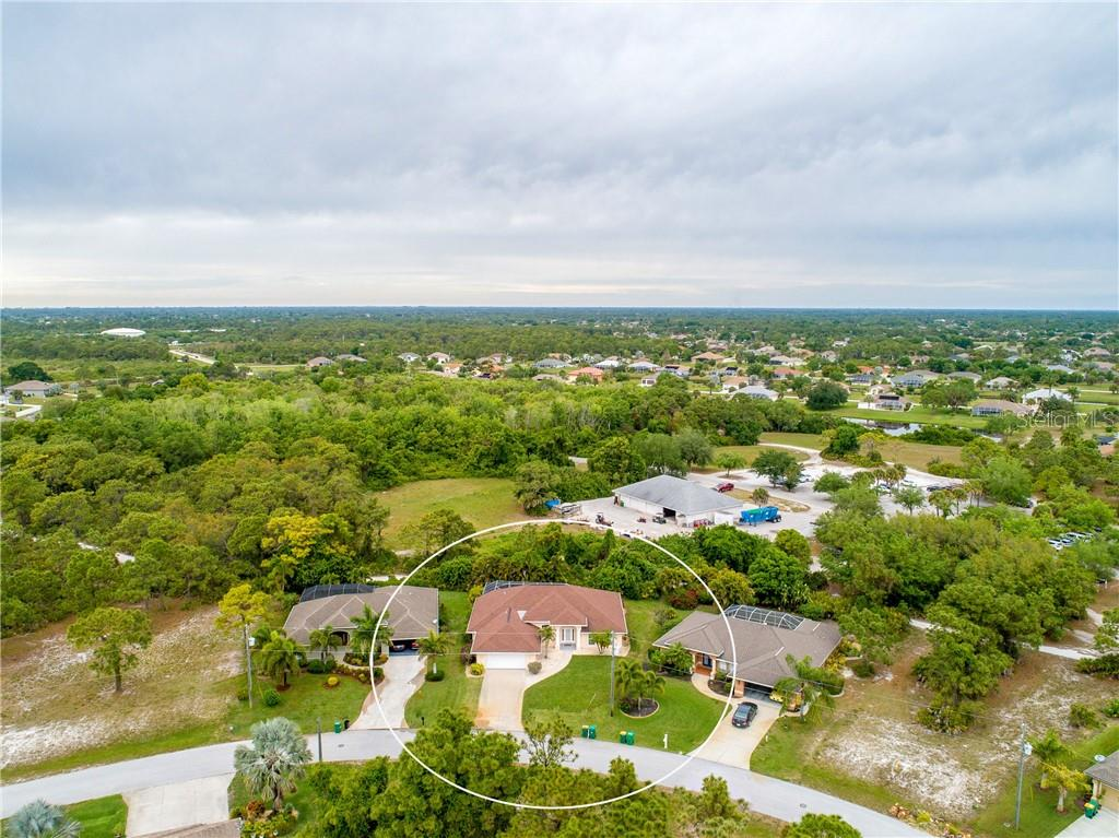 An aerial view of the property, surrounding neighborhood and surrounding area. - Single Family Home for sale at 30 Medalist Way, Rotonda West, FL 33947 - MLS Number is D6106239