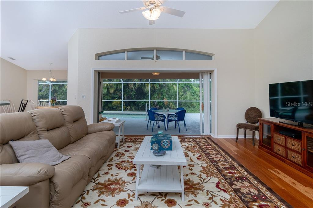 Living room has sliding glass doors to Lanai which can be left open to extend your living space outdoors. - Single Family Home for sale at 30 Medalist Way, Rotonda West, FL 33947 - MLS Number is D6106239