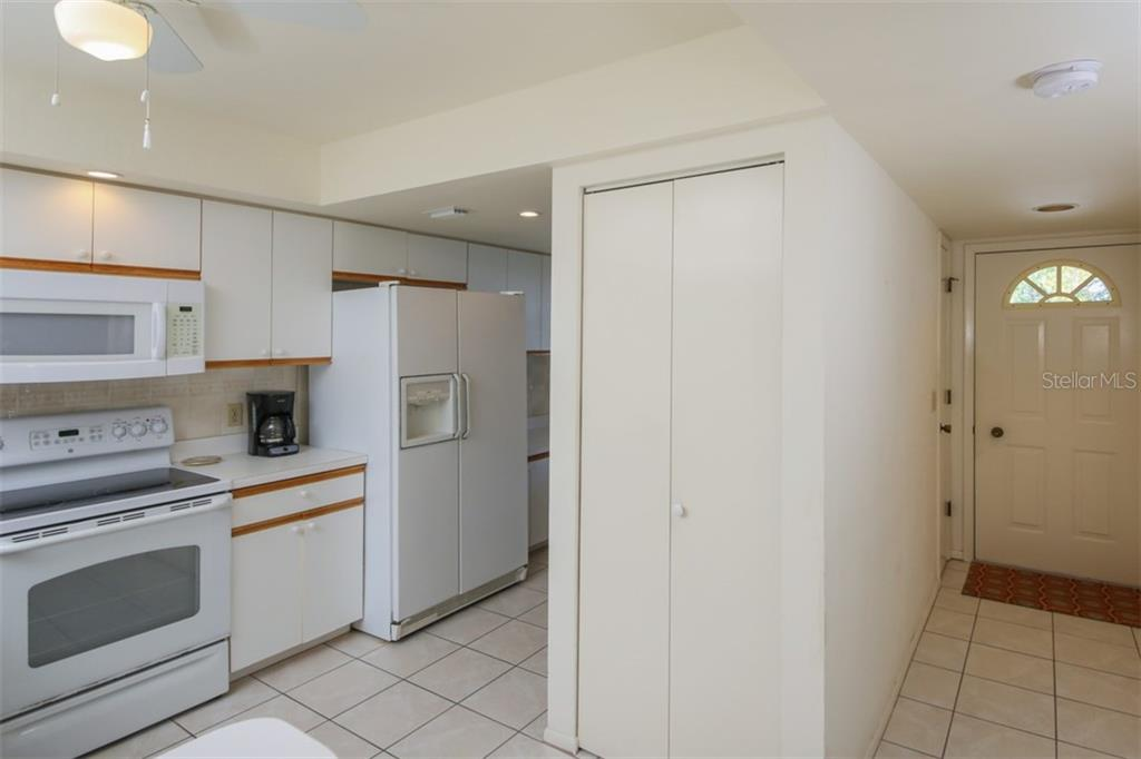 Bright, white kitchen - Condo for sale at 6800 Placida Rd #271, Englewood, FL 34224 - MLS Number is D6106459
