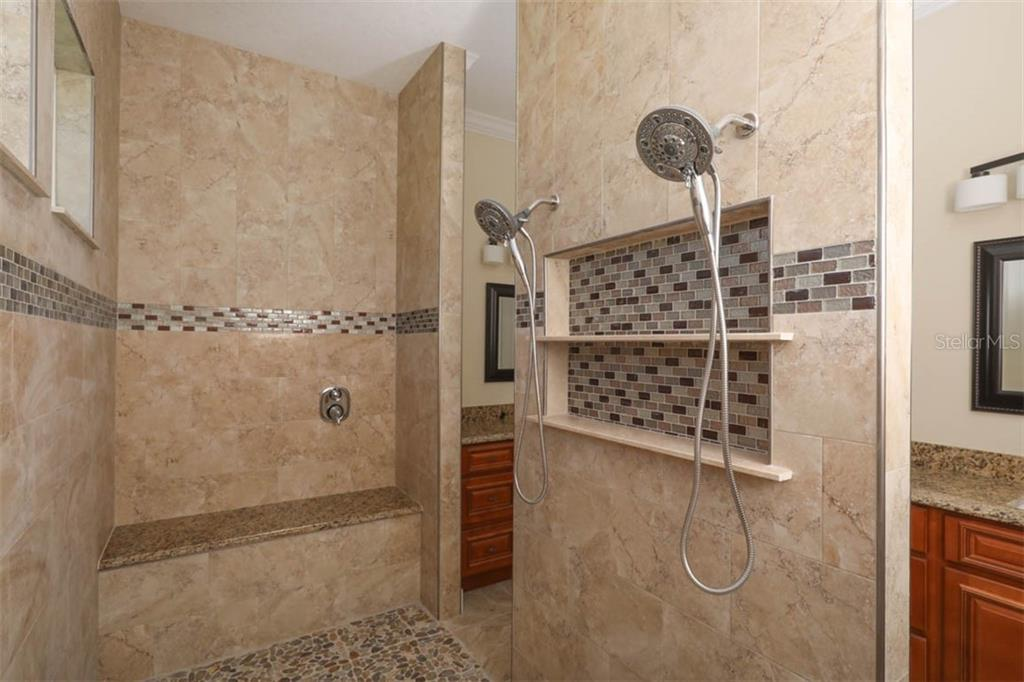 walk through shower in the master - Single Family Home for sale at 15586 Seafoam Cir, Port Charlotte, FL 33981 - MLS Number is D6106527
