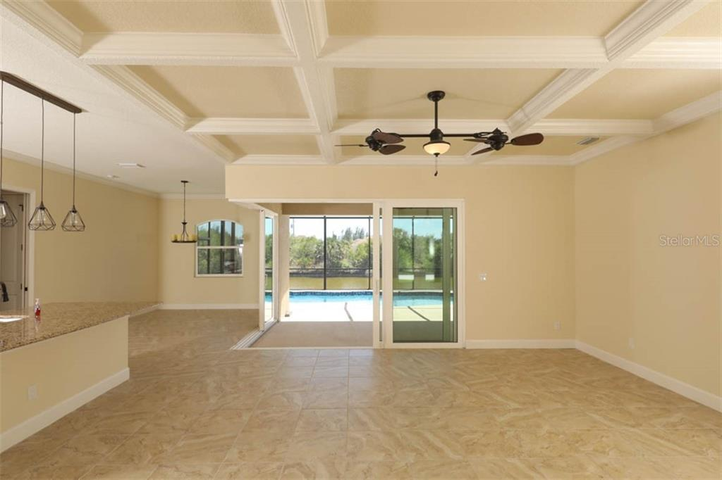 notice that ceiling and the designer fixtures - Single Family Home for sale at 15586 Seafoam Cir, Port Charlotte, FL 33981 - MLS Number is D6106527