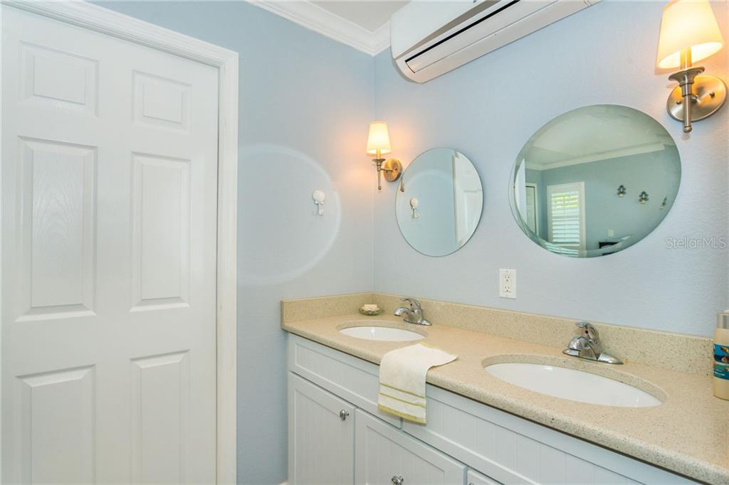 Double sink vanity in the in-law suite - Single Family Home for sale at 190 W Wentworth St, Englewood, FL 34223 - MLS Number is D6106918