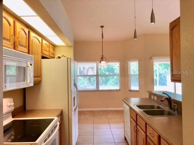 Kitchen Opens to Breakfast Nook - Single Family Home for sale at 2291 Meetze St, Port Charlotte, FL 33953 - MLS Number is D6107685
