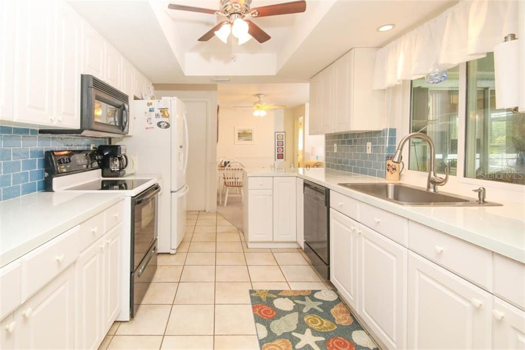 remodeled kitchen with new countertops & backsplash - Single Family Home for sale at 913 Tropical Ave Nw, Port Charlotte, FL 33948 - MLS Number is D6108061