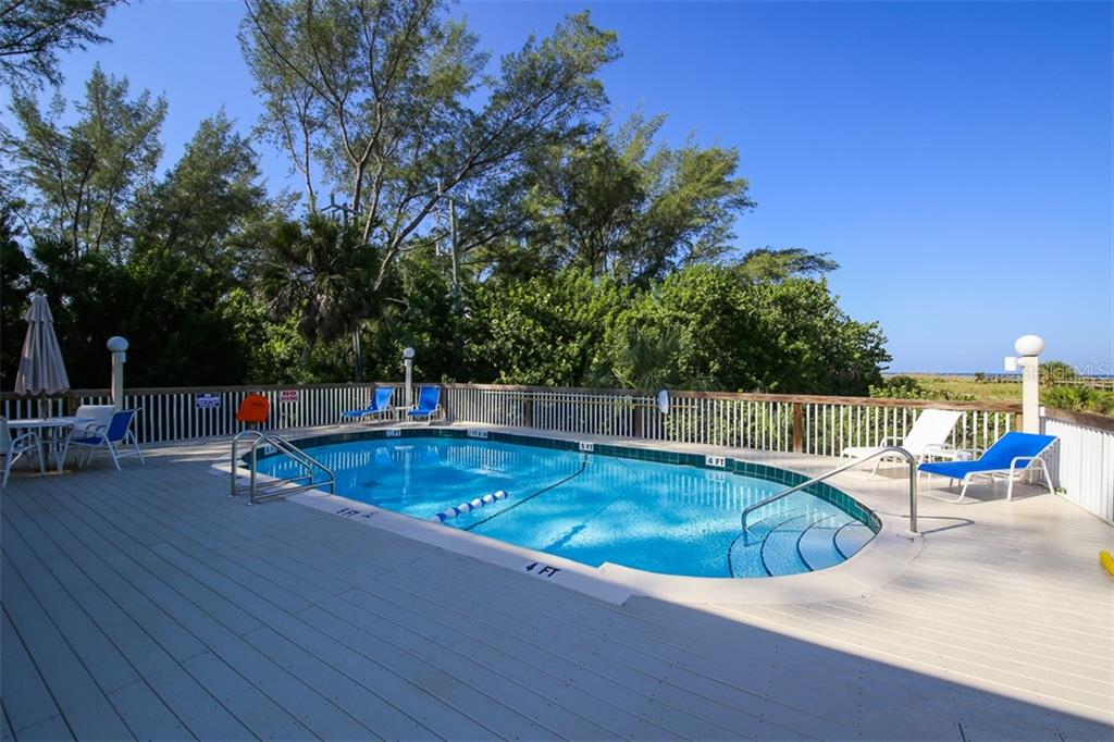 Refresh yourself by taking a dip in the pool on Little Gasparilla Island after a day at the beach - Condo for sale at 11000 Placida Rd #2301, Placida, FL 33946 - MLS Number is D6108434